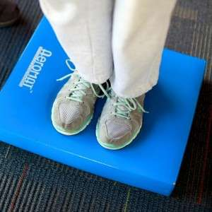 older adult performs balance training