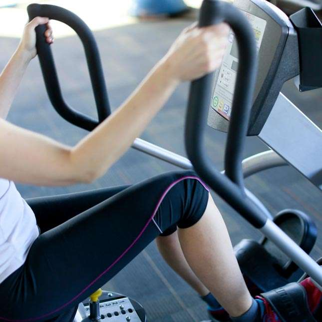 A woman rides the recumbent elliptical at Focus Physical Therapy, Bend.