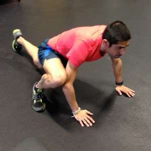 Mario Mendoza demonstrates the mountain climber running stretch for Posterior and Anterior Obliques