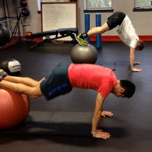 Two pro runners demonstrate Ball Pikeups to strengthen the Anterior Oblique Sling and Inner Core Unit