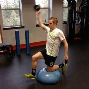 Hip Strength is challenged with the Kneeling BOSU Hip Stability exercise demonstrated by Ryan Bak