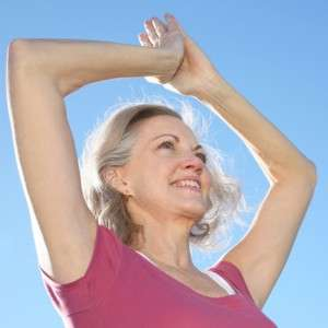 Woman with arms overhead-lymphedema